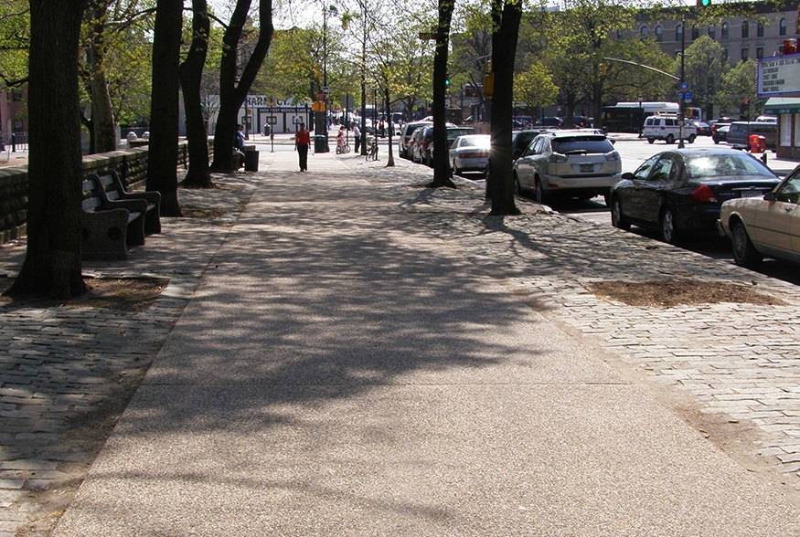 Sand-colored concrete sidewalk with exposed aggregate: Prospect Park West, Brooklyn